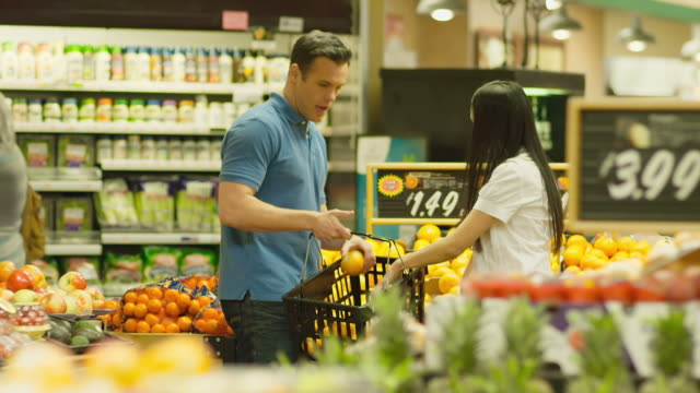 Couple picking out produce video