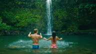 Couple Playing and Kissing Under Waterfall video