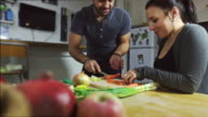 Couple preparing food in the kitchenl video