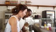Couple preparing sandwiches at a sandwich bar counter, shot on R3D video