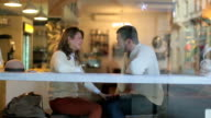 Couple  relax in modern cafe video