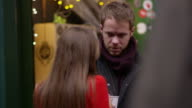 Couple Relax With Hot Drink At Christmas Market Shot On R3D video