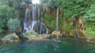 Couple relaxing at Roski slap waterfalls on Krka river video