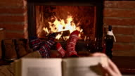 DS Couple relaxing by the fireplace video