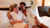 Couple Relaxing In Hotel Room Wearing Robes video
