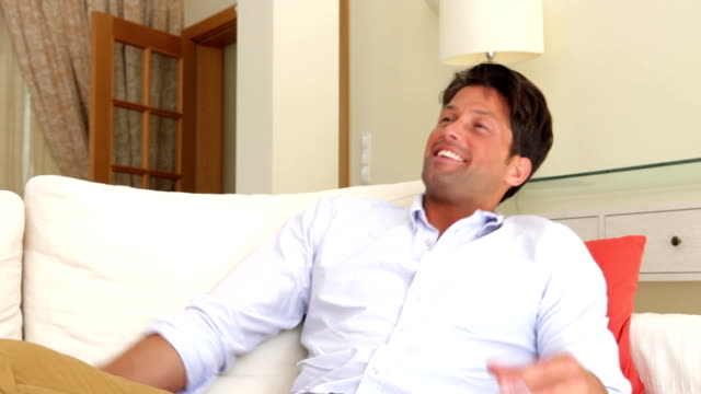 Couple Relaxing On Sofa Together video