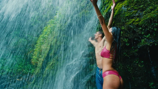 Couple Relaxing Under Waterfall video