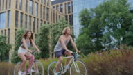 Couple riding bicycles in the city video