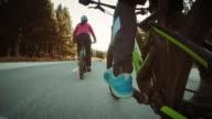 POV Couple riding bikes along a country road video