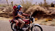Couple riding together on motorcycle video