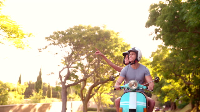 Couple road tripping on their scooter feeling free video