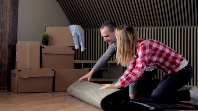 Couple rolling out carpet for their new house video
