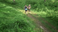 AERIAL Couple running a marathon through forest video