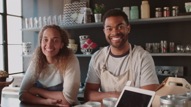 Couple Running Coffee Shop Behind Counter Shot On R3D video