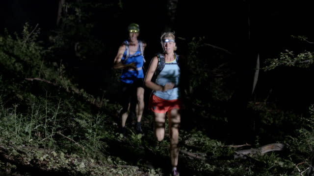 SLO MO Couple running in forest at night video
