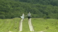 Couple Running In The Field video