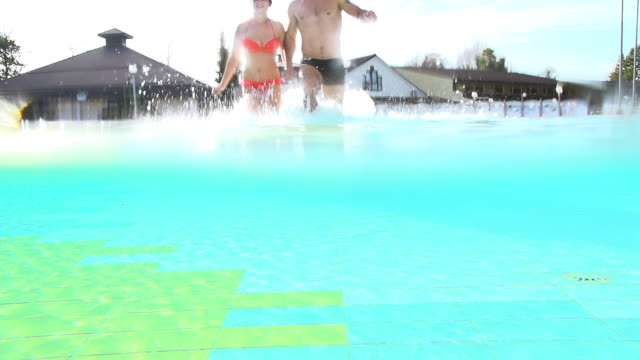 HD SUPER SLOW-MO: Couple Running In The Pool video