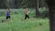 SLO MO DS Couple running on forest trail video