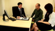 Couple sat in meeting with Financial advisor video