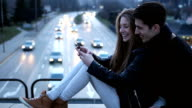Couple sharing warm springtime evening in the city video