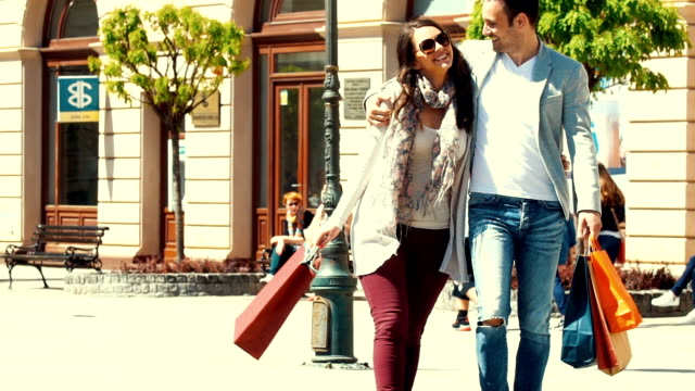 Couple shopping in slow motion. video