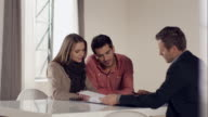 Couple signing contract for new apartment video