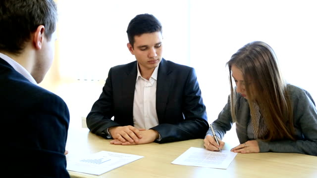 Couple signs formal paper video
