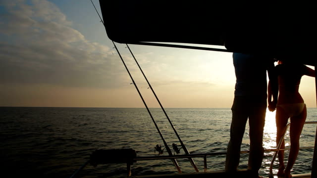 Couple Silhouette on Yacht at Sunset video