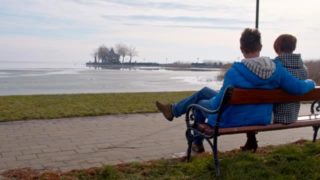 Couple sitting by the lake Balaton video