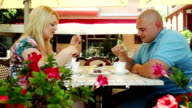 Couple sitting in summer cafe video
