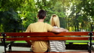 Couple sitting on bench video