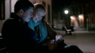 Couple Sitting on the Bench with Tablet video