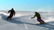 SLO MO Couple skiing down the slope video