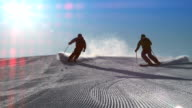 SLO MO LD Couple skiing on a sunny day video