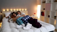Couple sleeping on bed video