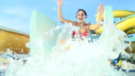 HD SUPER SLOW-MO: Couple Sliding On Water Slide video