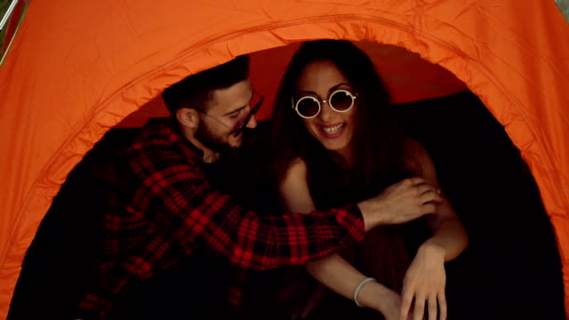 Couple smiling in the tent video