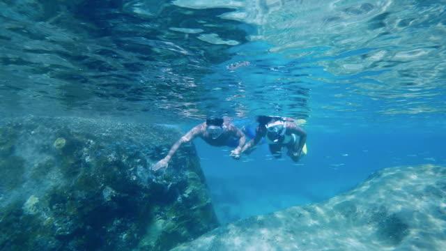 couple snorkeling on the reef in Virgin Gorda video