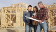 Couple speaking to contractor about floor plan video