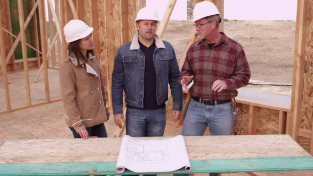 Couple speaking to contractor video