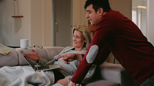 Couple spending a relaxing weekend at home video