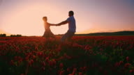 SLO MO Couple spinning in the field of blooming clover video