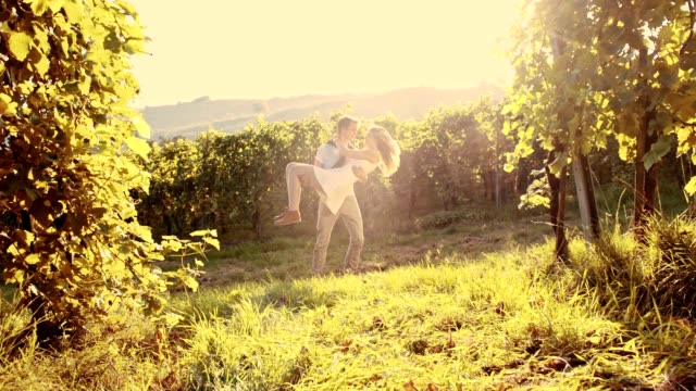 SLO MO Couple spinning in the vineyard video