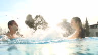 HD SUPER SLOW-MO: Couple Splashing Each Other video