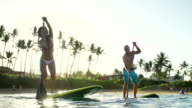 Couple Stand Up Paddle Surfing, Summer Sport with Lens Flare video