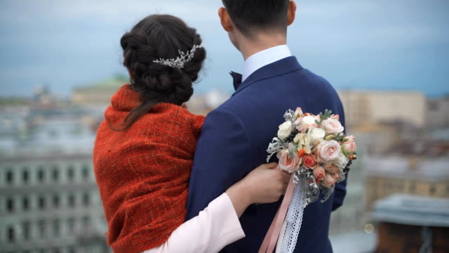 Couple standing on the roof. Happy bride and groom video