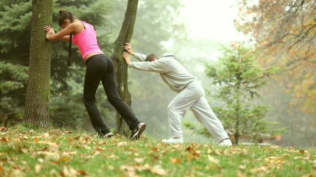 Couple stretching together video
