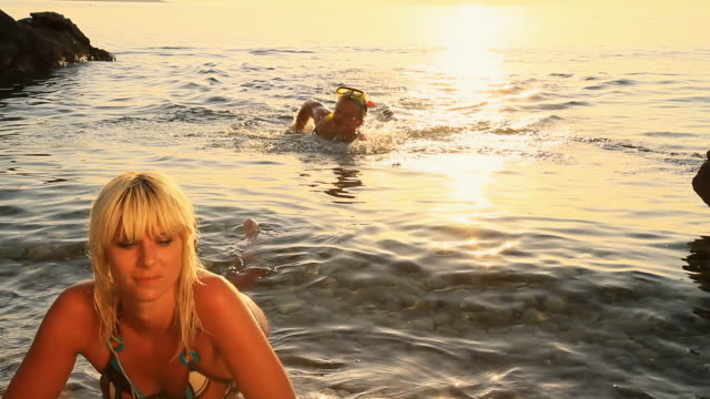 HD: Couple Swimming At Sunset video