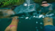 Couple Swimming to Waterfall video