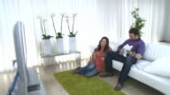 Couple take relaxing time out in livingroom video